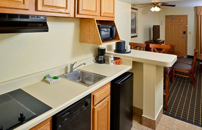 Inexpensive Hotel With Washer, Dryer, And Kitchen For Family Of 5.