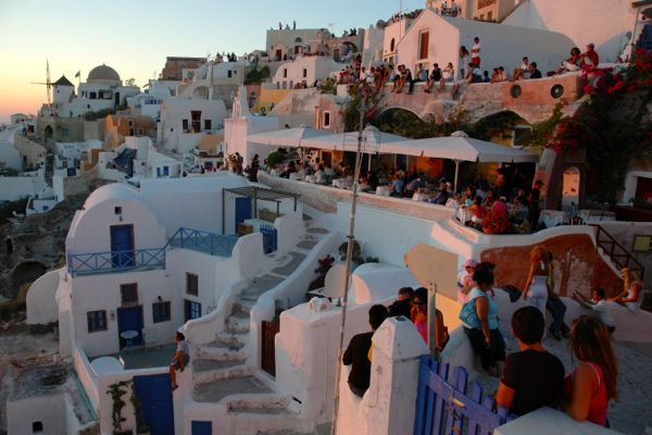 Tourists watching the sunset in Oia, Santorini.