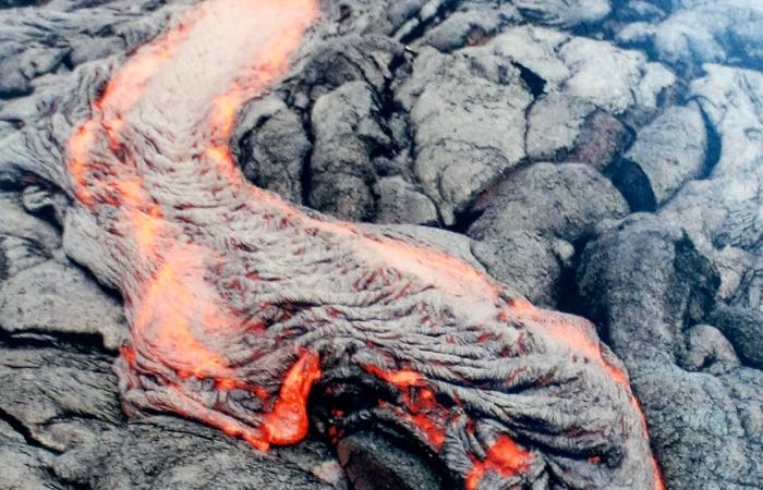 Get within feet of a lava flow at Volcanoes National Park