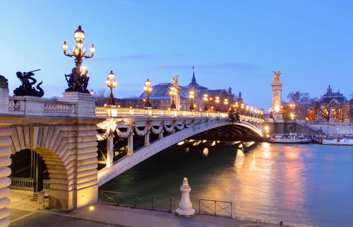 From the Berges des Seine, Pont Alexandre III and Grand Palais at dusk, Paris.