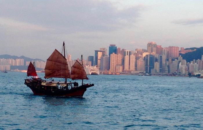 Sail in Hong Kong's Victoria Harbor on a traditional Chinese Junk boat.