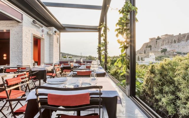 Luxury hotel in Athens near Plaka with view of Parthenon.