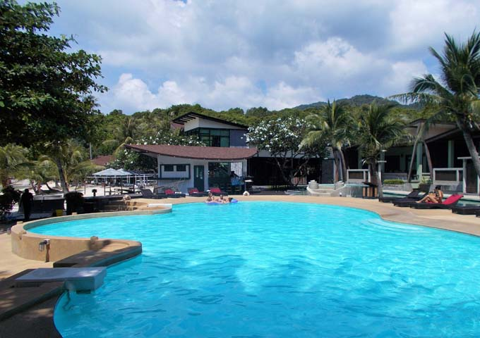 Beach-facing main pool and modern accommodations at kids-friendly Cocohut Beach Resort