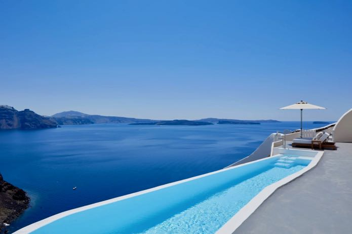 Oia hotel with private pool and caldera view.