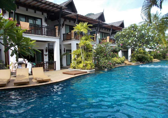 Villas with traditional thatched roofs and amazing pool at Railay Village