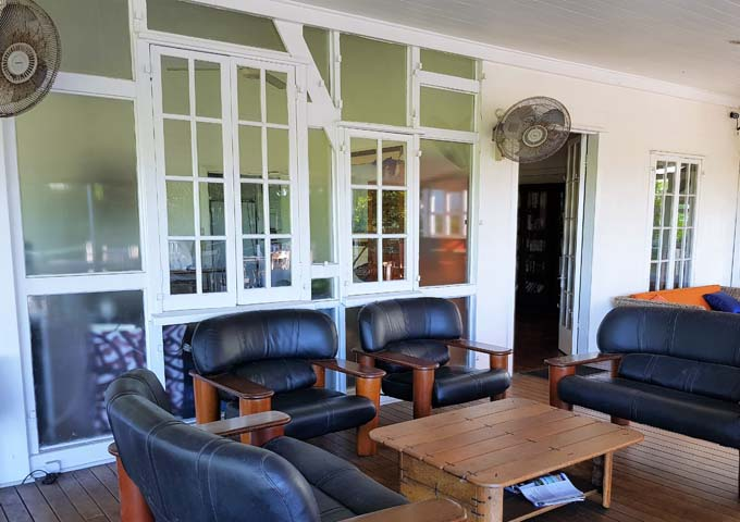 Guests' lounge features a comfortable veranda setting also.
