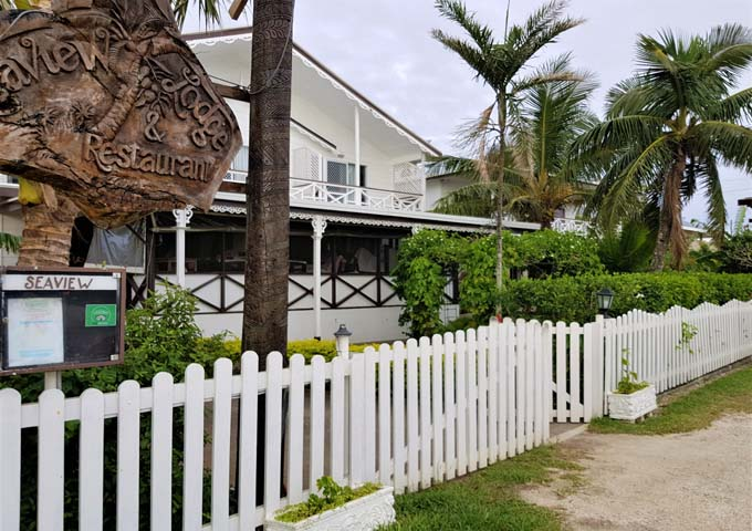 Whitewashed walls and picket fence give the hotel a colonial charm.