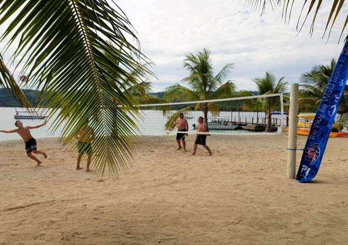 Families can enjoy activities like beach volleyball.