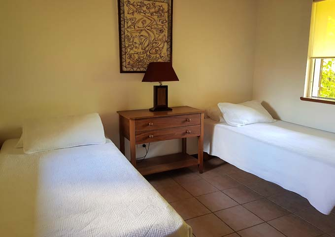 Second bedrooms feature traditional art on the walls.