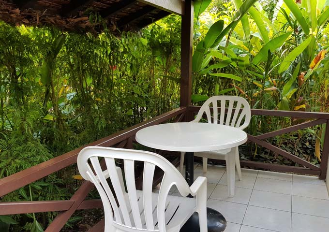 Bungalow balconies are surrounded by tropical gardens.