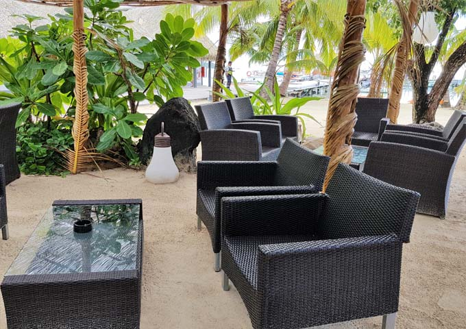 Motu Iti Bar has outdoor seating on sand.