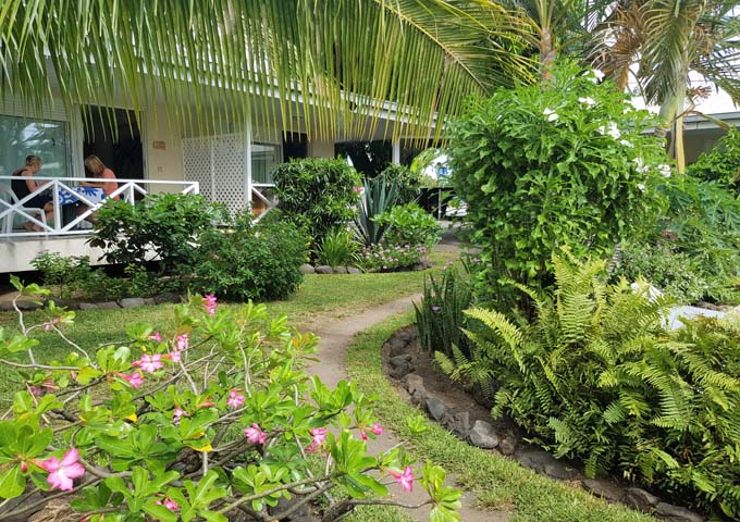 Rooms open up to lush tropical gardens.
