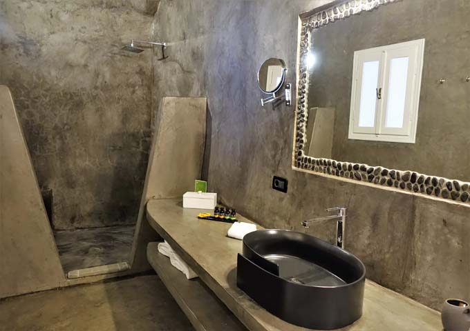 The bathrooms are cave-style with open shower and modern fixtures.