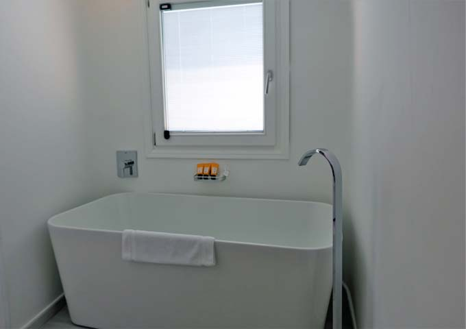 The bathroom also features a nice big tub.