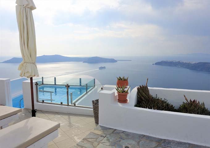 The reception leads to the pool which offers fantastic caldera views.
