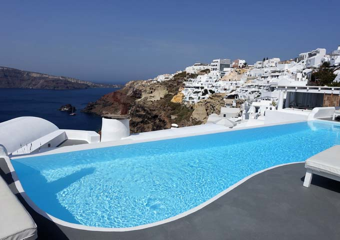 On the right of the pool is the Mikrasia Restaurant and Oia village.