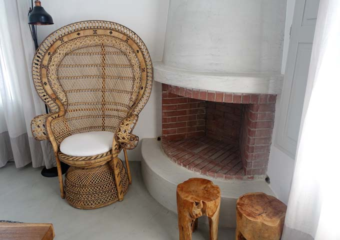 The villa's living area has a fireplace and a sofa bed.