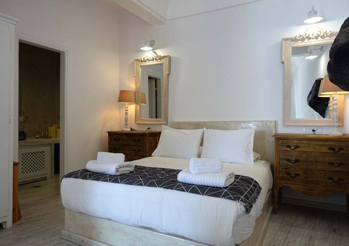 The villa's bedroom are spacious with a bathroom on the side.