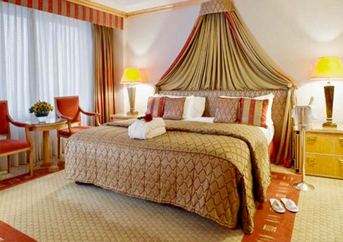 The Royal Suite bedroom has an oversized bed, and premium drinks in the minibar.
