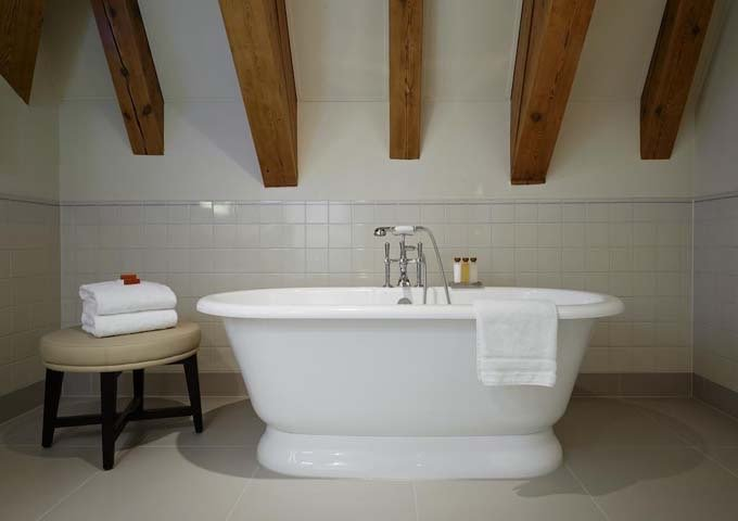 Many bathrooms feature free-standing tubs.