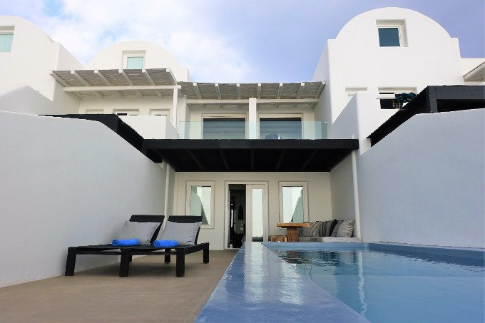 The Pool Suite's terrace has a heated infinity pool, dining area, and sun loungers.