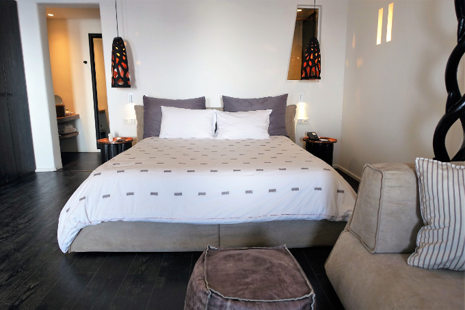 The suite has an open-plan layout and a king bed.