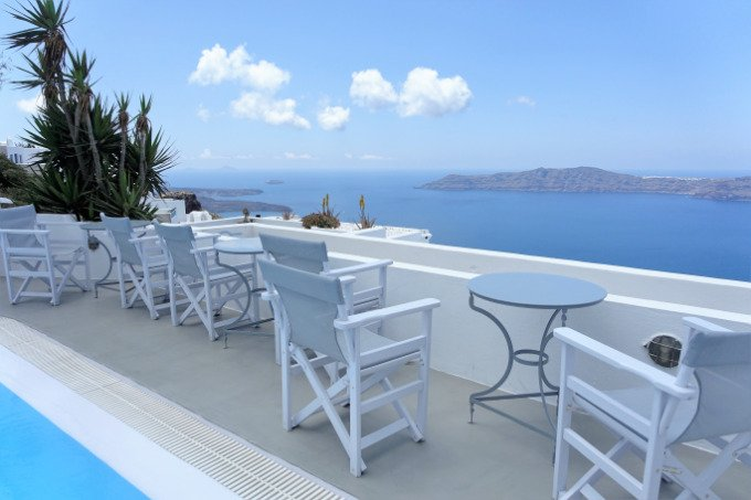 The veranda is a popular spot to enjoy cocktails, sunsets, and caldera views.