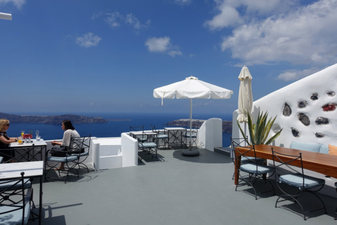 Breakfast is served on the terrace, which offers panoramic caldera views.
