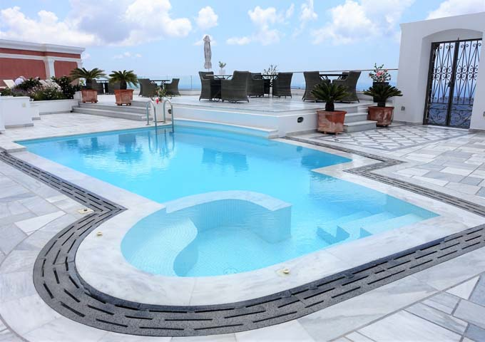 The courtyard features a pool with attached jacuzzi, dining terrace, and fantastic views.