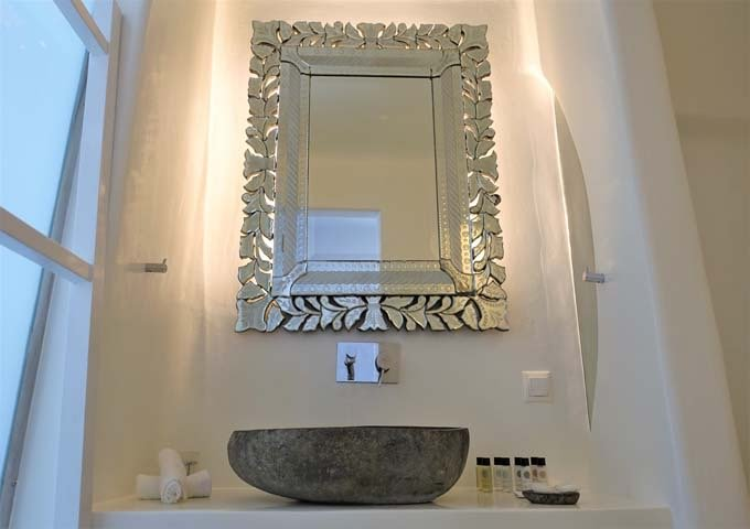 The bathroom has a natural stone sink.