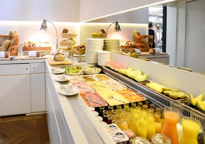 The breakfast buffet includes eggs cooked to order, Dutch pancakes, and champagne.