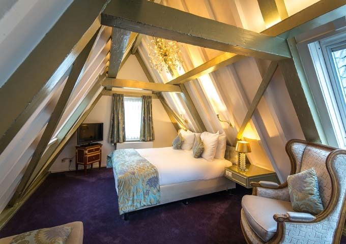 The top-floor Grand Suite feature heavy wooden beams and lofty views.