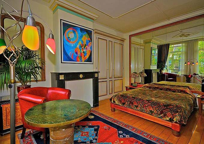 Canal Room #6 features 1920's furniture and views of the intersection of 2 canals.