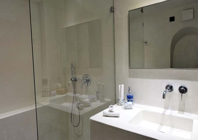 The ensuite bathroom is made of pressed concrete and marble dust.