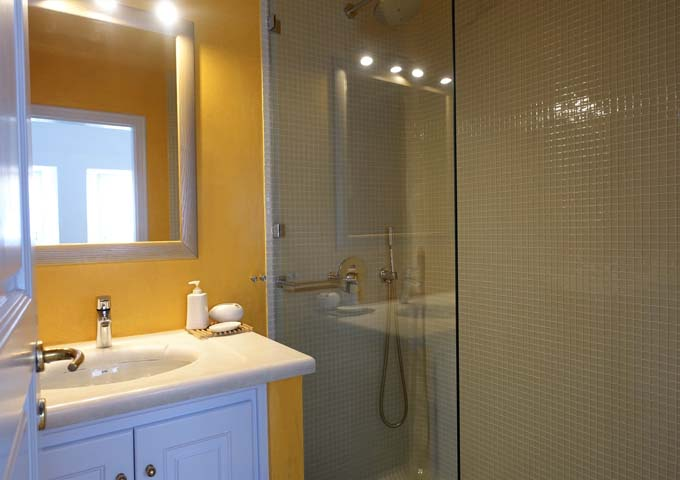 The suite's bathroom is decorated with yellow tiles.