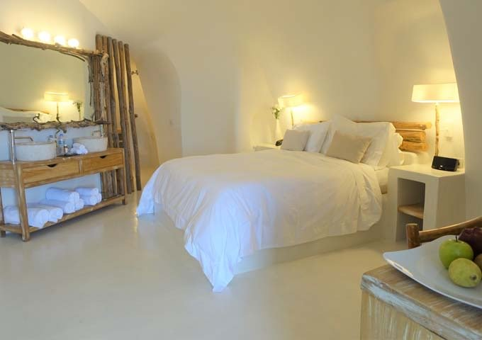 The bedroom has a cave-style architecture, with dual vanities.