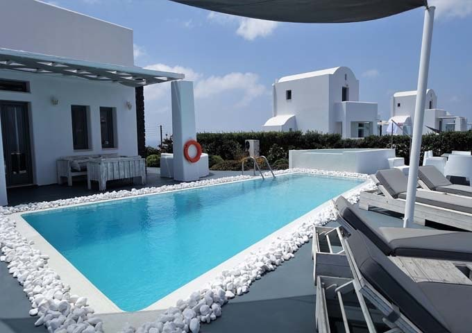 The private pool is of decent size, and has plenty of sun-loungers around.