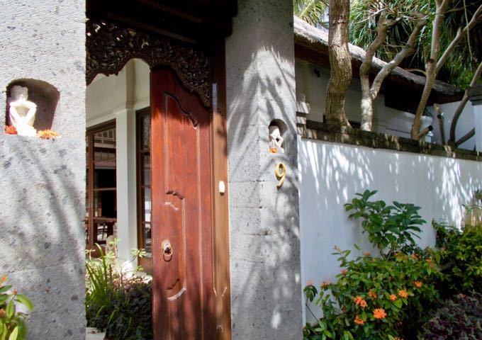 The secluded villas have entrances which feature ornamental doors.