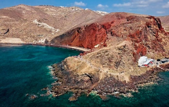 View of Santorini Beaches on private helicopter transfer from Mykonos to Santorini.