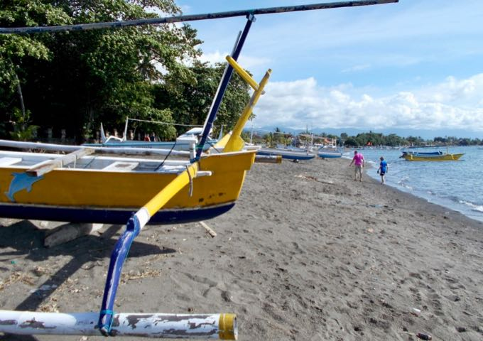 The beach is often lined with fishing boats.