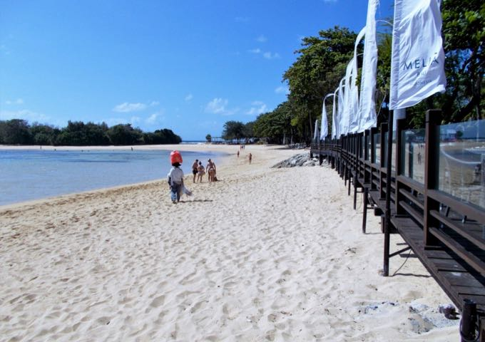 The resort beach offers white sand, calm water, and excellent views.