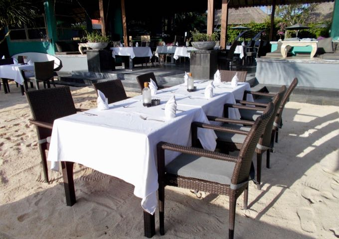 The beachside restaurant offers fine dining on the sand.