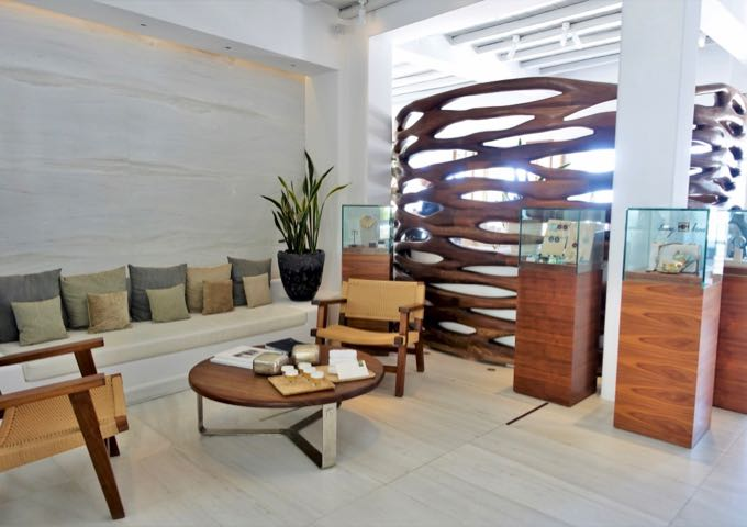 The small but sophisticated lobby has a mix of marble and wood, and a selection of jewelry from their on-site shop.