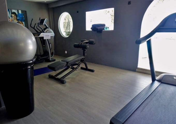 The small hotel gym has modern equipment.