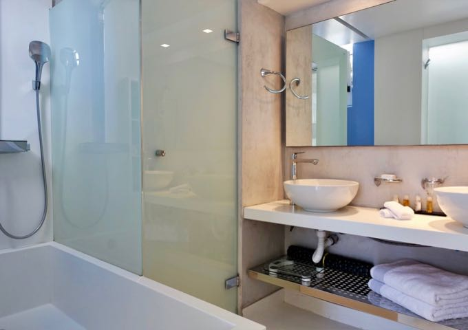 The bathroom has a shower-tub combo and dual vanities.