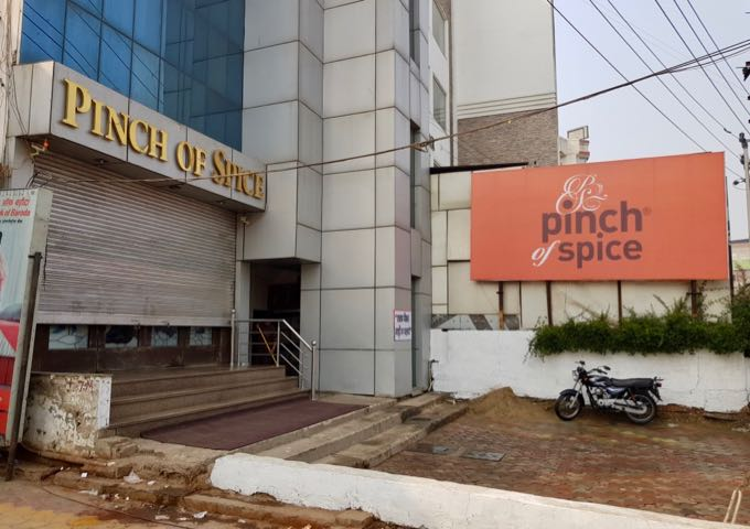 Pinch of Spice café opposite the hotel serves good food.