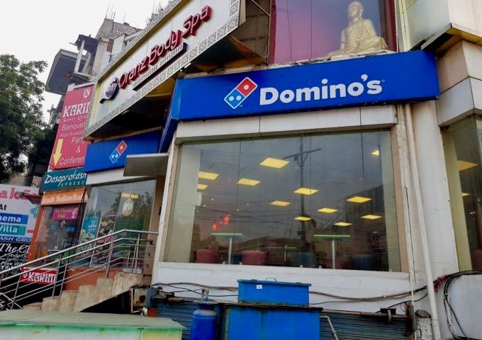 The corner of the lane to the hotel has a Domino's outlet.