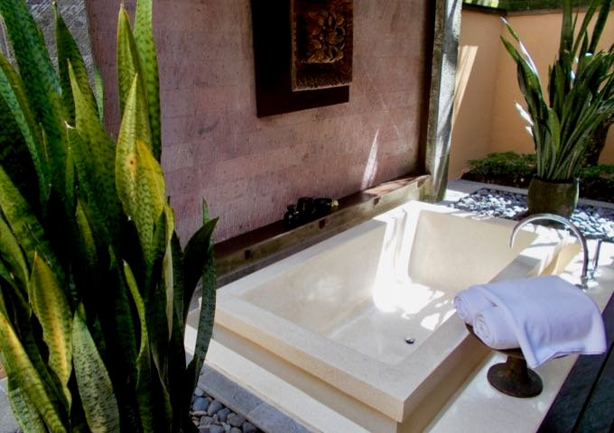 Pool Villas come with open-air bathrooms and sunken bathtubs.