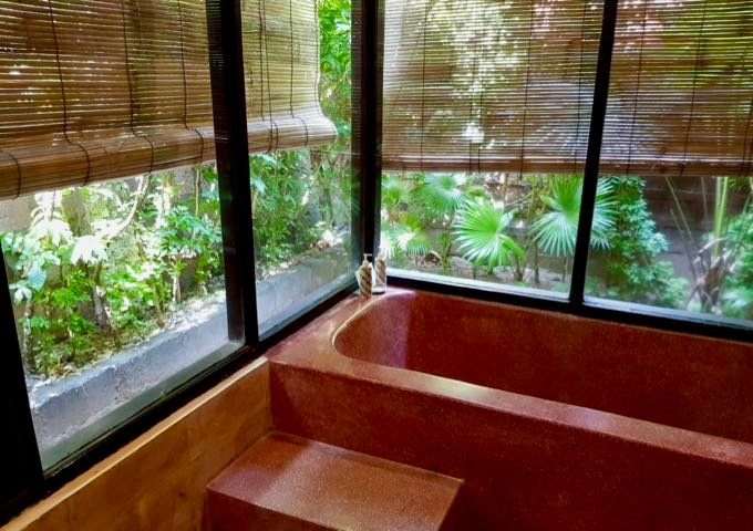 Superior Star Rooms' bathrooms offer views of private gardens.
