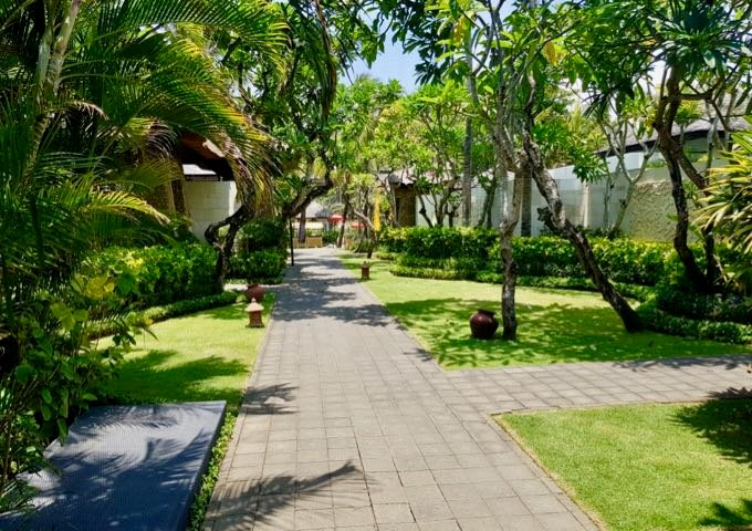 Luxurious villas are connected by garden paths.